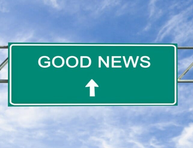 "Picture of a road sign that says, ""Good News"" with an arrow pointing straight ahead."