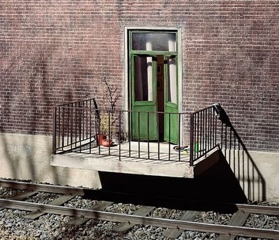 Image of a balcony built over railroad tracks.