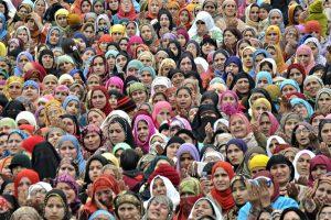 Kashmiri Muslim women watch as a hair from the beard of Prophet Muhammad is shown.