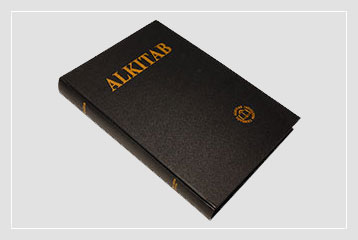 """Gambar Alkitab terbuka. Di halamannya tertulis, """"Kitab Suci."""""""