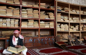 Man reading the Quran in the Grand Mosque in Sana, the capital of Yemen.