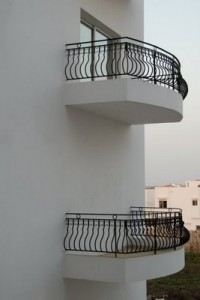 Picture of two balconies: one with a door and one without.